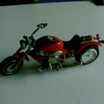 delightful diecast model motorcycle that has actual clock in rear wheel nice display piece